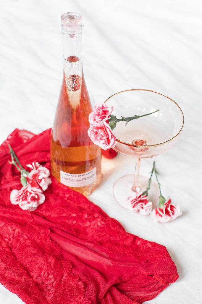 Bottle Of Champagne With Pink Flowers