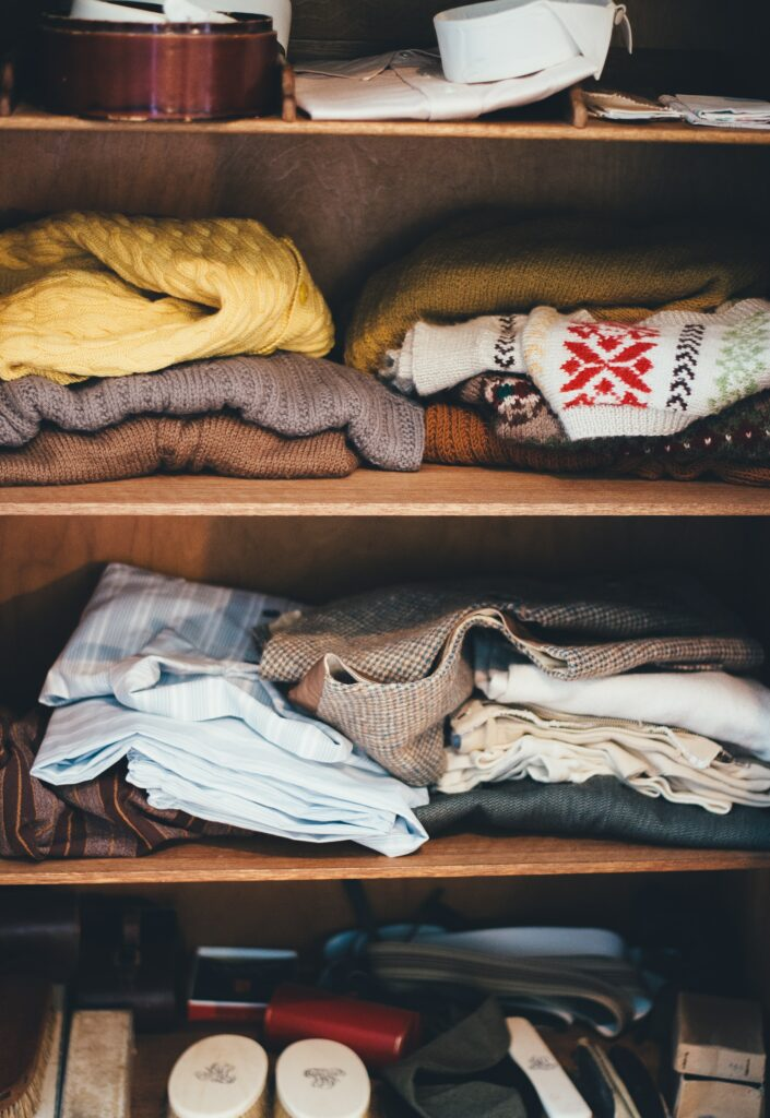 Closet Shelves With Folded Clothes