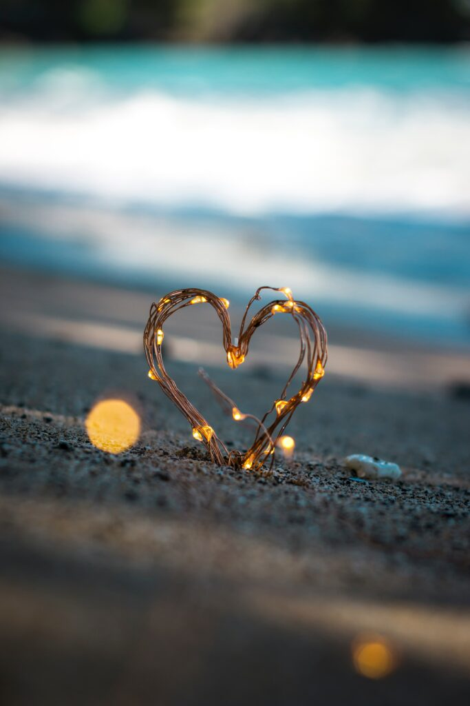 Twig Heart With Lights On Beach