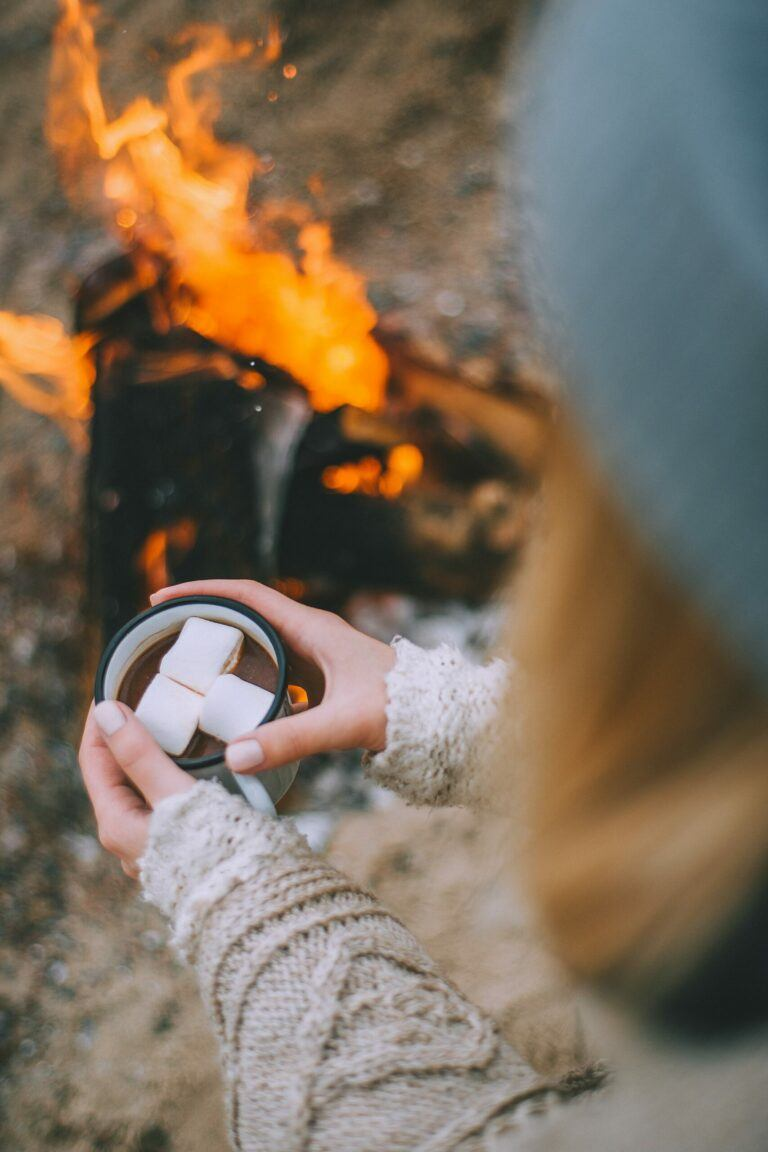 Upgrade Your Fall With A Portable Backyard Fire Pit Woman With Cocoa